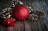 Christmas ball and candle — Stock fotografie
