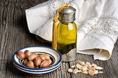 Argan oil and fruit — Stock Photo