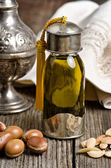 Argan oil with fruits — Stock Photo