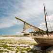 Boat grounded on a beautiful beach — Stock Photo