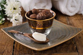 Shea butter and shea nuts — Stock Photo