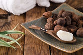 Shea butter and shea nuts — Stock Photo