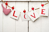Message of Love written on paper cards — Stock Photo