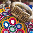 Ethnic bracelet and needlework — Stock Photo #19579975