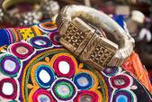 Ethnic bracelet and needlework — Stock Photo