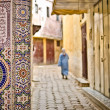 Street of Meknes with decorating tiles - Stock Photo