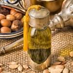 Still life of argan fruit and oil — Stock Photo