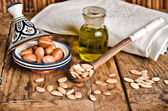 Still life of argan fruit and oil — Stock Photo