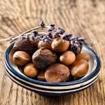 Argan fruit in a moroccan dish — Stock Photo