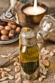 Still life of argan oil with fruits — Stock Photo