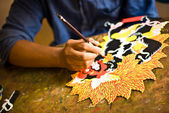 Craftsman painting a marionette in Bali — Stock Photo