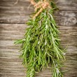 Rosemary on wood — Stock Photo