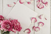 White paper with flowers and petals — Stock Photo