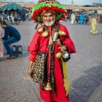 Water peddler in the famous Djemaa El Fna, Marrakech — Stock Photo #27813781