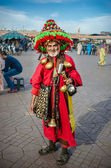 Water peddler in the famous Djemaa El Fna, Marrakech — Stock Photo
