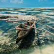 Boat in the low tide of Zanzibar — Stock Photo