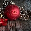 Christmas ball and candle — Stock Photo