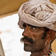 Man from rajasthan with a twisted turban — Stock Photo