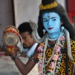 Stock Photo: India, young man performing God Shiva