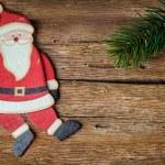 Santa claus decoration on wood — Stock Photo #36582307