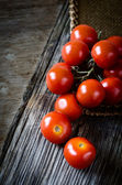Fresh tomatoes on a table — Stock Photo