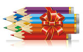 Colored pencils with a ribbon and bow (vector) — 图库矢量图片
