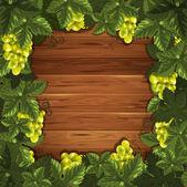 木制背景上葡萄 — 图库矢量图片