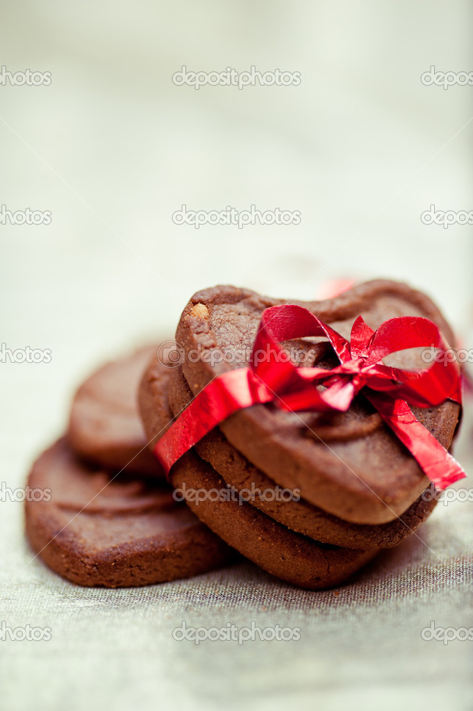 Three heart shaped cookies tighten with the red ribbon  Foto Stock #19216961