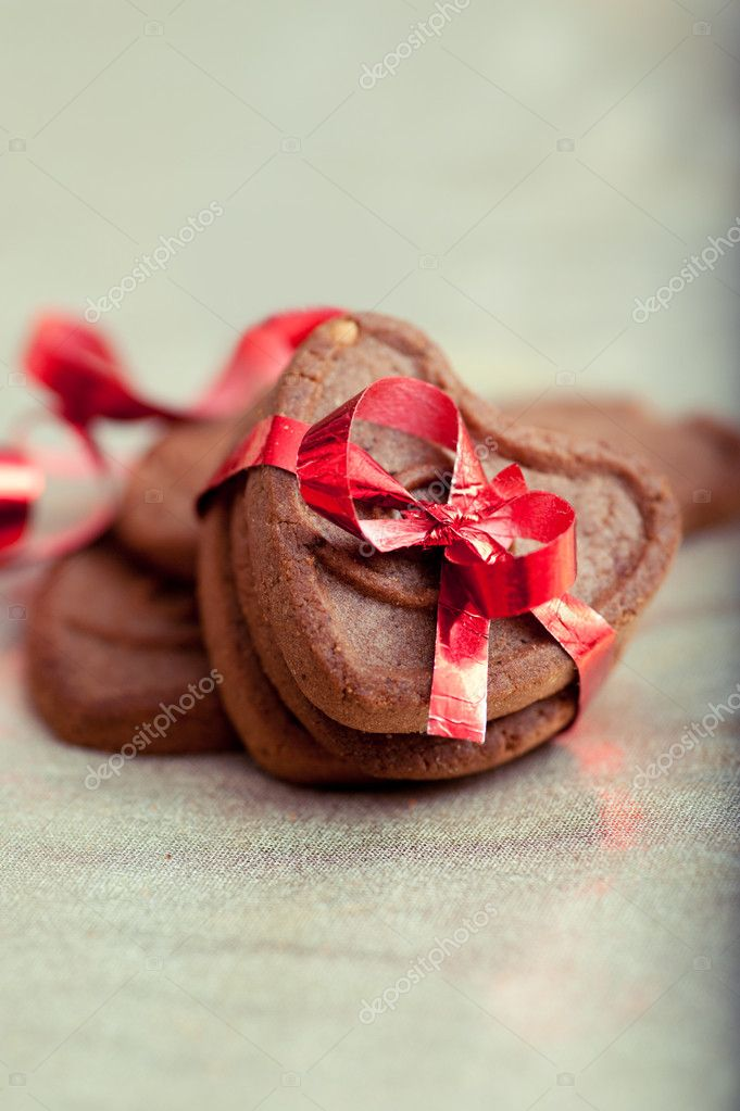 Three heart shaped cookies tighten with the red ribbon  Stock Photo #19217009