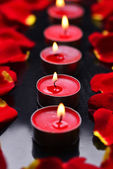 Candles with rose petals — Stock Photo