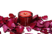 Petals and red candle — Stock Photo