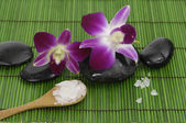 Orchid and stone on mat — Stock Photo