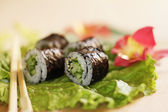 Sushi on lettuce — Stock Photo