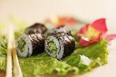 Sushi on lettuce — Stock Photo