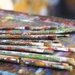 Brushes on drawing board — Stock Photo
