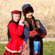 Man and  woman in Russian national clothes — Stockfoto