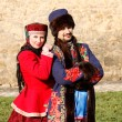 Man and woman in Russian national clothes — Stock Photo