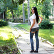 Young girl with big breasts in torn jeans — Foto Stock