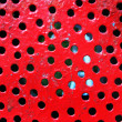 Stock Photo: Metal painted red with holes