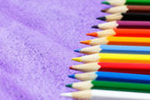 Multicolored pencils for drawing on violet background — Stock Photo