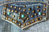 Jeans pocket decorated with turquoise closeup — Stock Photo