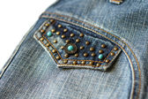 Jeans decorated with turquoise fragment closeup — Stock Photo