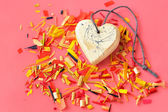 Heart and colored confetti — Stock Photo