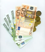 Banknotes, euros and cents — Stock Photo