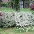 White chair in a garden — Foto Stock