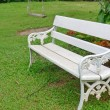 Stock Photo: White chair in a garden