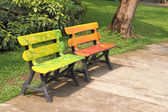 Two wooden chairs in a park — Stock Photo