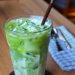 Glass of ice green tea — Stock Photo