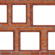 Blank wooden frame on brick wall background — Stock Photo