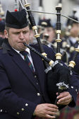Piper at the Cowal Gathering Highland Games in Scotland — Stock Photo